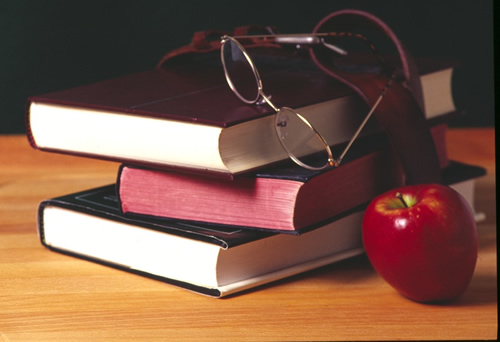 3 books with an apple